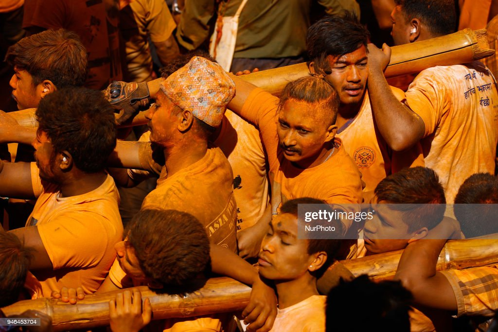 Nepalese devotees dance and play traditional drums during Sindoor Jatra festival in Thimi, Nepal, April 15, 2018. Devotees mark the festival by playing traditional drums, singing, dancing and carrying chariot of various deities around town while throwing vermillion powder to welcome the advent of spring and the New Year.