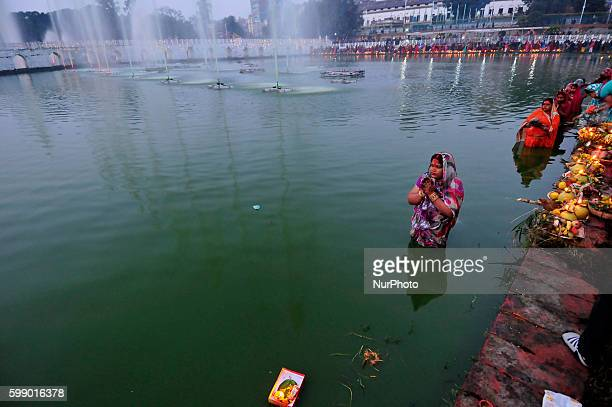 Nepalese Devotees dip into pond and awaits for the rising sun on the 4th day of Chhath Puja Festival at Rani Pokhari Kathmandu Nepal on 18 November...