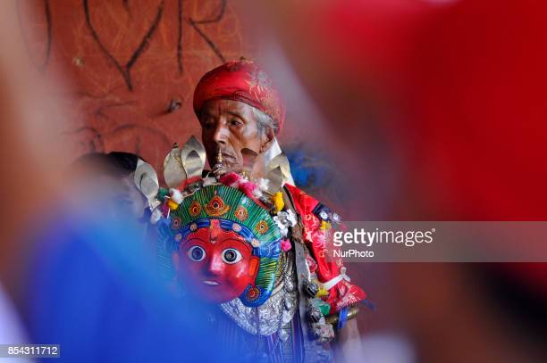 Nepalese devotees impersonate as deity wearing traditional deity clothes and ornaments for the celebration of Shikali Festival at Khokana Village...