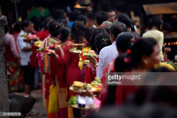 An illumunated view of Bagh Bhairab temple as devotees pictured as they circumambulate on the occasion of the Bagh Bhairab festival celebrated at...