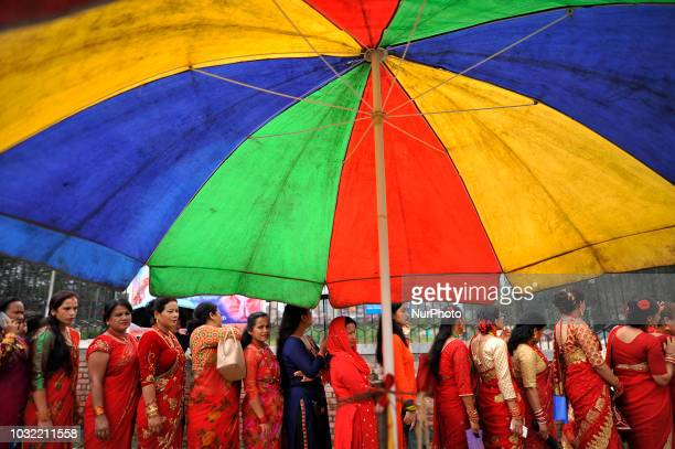 Nepalese devotees lining to offer rituals during Teej festival celebrations at Pashupatinath Temple, Katmandu, Nepal on Wednesday, September 12,...