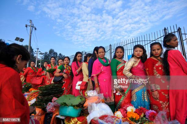 Nepalese devotees lining to offer rituals during Teej festival celebrations at Pashupatinath Temple Kathmandu Nepal on Thursday August 24 2017 The...