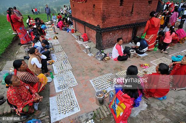 KHOKANA PATAN PATAN NP NEPAL Nepalese devotees offering butter lamps around the premises of Shikali Temple during celebration of Shikali Festival at...
