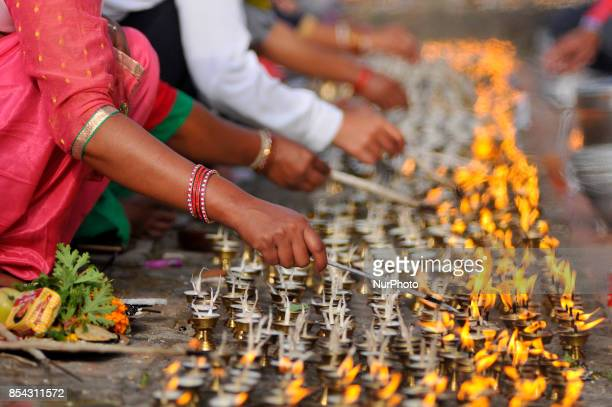Nepalese devotees offering butter lamps during celebration of Shikali Festival at Khokana Village Patan Nepal on Tuesday September 26 2017 People...