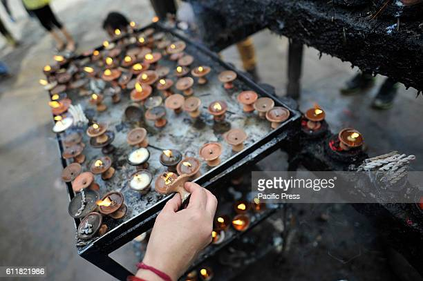 Nepalese devotees offering butter lamps infornt of Kaal Bhairab during the Gatasthapana first day of Biggest Hindu festival Dashain at Nasal Chowk...