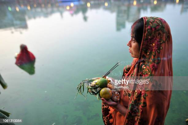 Nepalese Devotees offering fruits to the sun god on the fourth and last day of Chhath Puja Festival at Bagmati River Kathmandu Nepal on Wednesday...