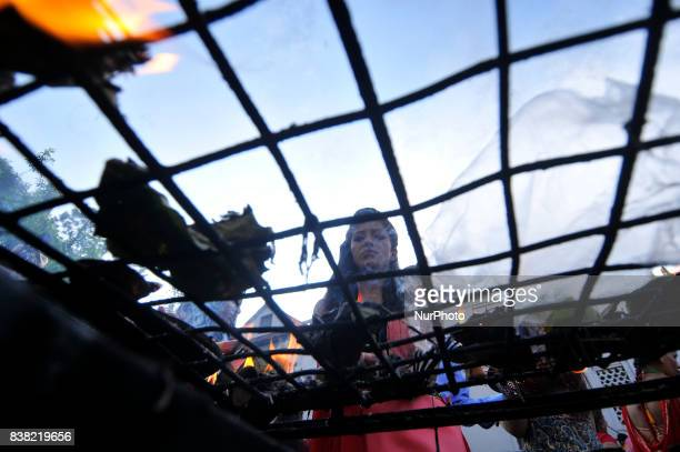 Nepalese devotees offering oil and butter lamps during Teej festival celebrations at Pashupatinath Temple Kathmandu Nepal on Thursday August 24 2017...