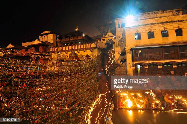 KATHMANDU NEPAL KATHMANDU NP NEPAL Nepalese devotees offering oil lamps towards lord Shiva inside the Pashupatinath Temple on the occasion of Bala...