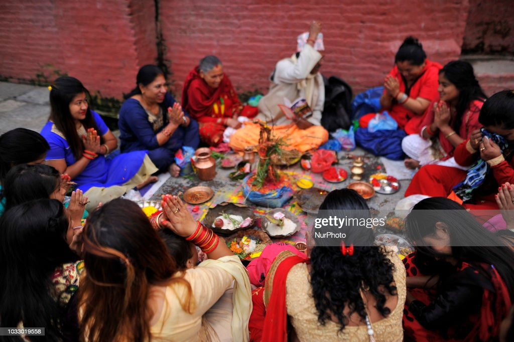 Nepalese devotees offering ritual prayer at the Bank of Bagmati River of Pashupatinath Temple during Rishi Panchami Festival celebrations at Pashupatinath Temple, Katmandu, Nepal on Friday, September 14, 2018. Rishi Panchami festival is celebrated as the last day of three-day long Teej Festival. The Teej festival is celebrated by Hindu women in Nepal as well as in some parts of India. During the three-day long festival, women observe a day-long fast and pray for the long life their husbands as well as for a happy family. Those who are unmarried pray for a good husband and a long life.