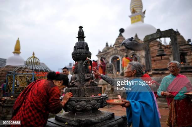 Nepalese devotees offering ritual prayer at the premises of Chiloncho Stupa during celebration of Buddha Purnima festival, Birth Anniversary of Lord...