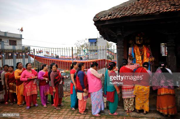 Nepalese devotees offering ritual prayer at the premises of Chiloncho Stupa during celebration of Buddha Purnima festival Birth Anniversary of Lord...