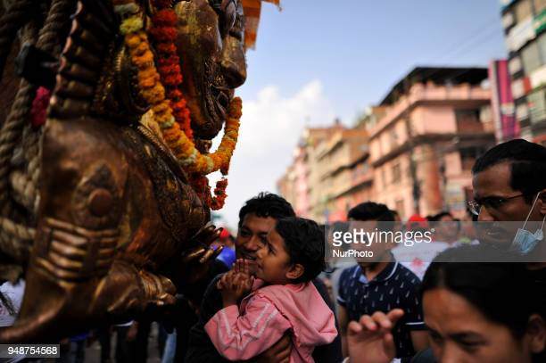 Nepalese Devotees offering ritual prayer during Chariot pulling festival of Rato Machindranath 'God of Rain' on first day at Pulchowk Lalitpur Nepal...