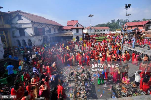 Nepalese devotees offering ritual prayer during Teej festival celebrations at Pashupatinath Temple Kathmandu Nepal on Thursday August 24 2017 The...