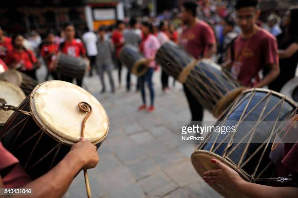 Nepalese devotees playing traditional instruments n the fourth day of Indra Jatra Festival celebrated at Basantapur Durbar Square Kathmandu Nepal on...