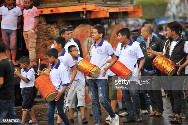 Nepalese devotees playing traditional musical instruments on celebration of Bhoto Jatra festival at Jawalakhel Patan Nepal on Thursday May 25 2017...