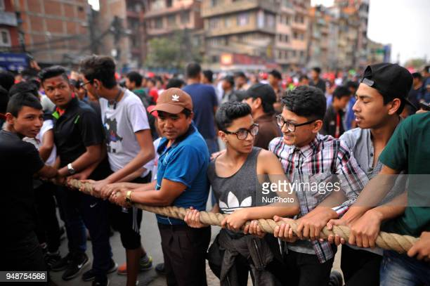 Nepalese devotees pulling the chariot of Rato Machindranath 'God of Rain' on first day at Pulchowk Lalitpur Nepal on Thursday April 19 2018 Rato...