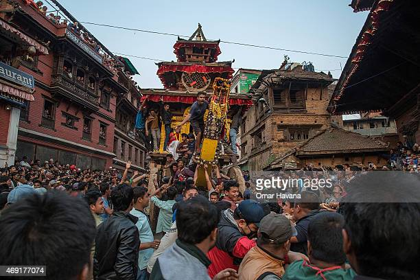 Nepalese devotees shout while directing other devotees to pull a wooden chariot on the first day of the Bisket Jatra festival on April 10 2015 in...