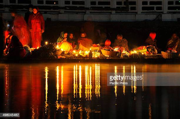 Nepalese devotees waiting for the rising sun on the 4th day of Chhath Puja Festival. Chhath Puja Festival, the worship of Sun God, is common in...