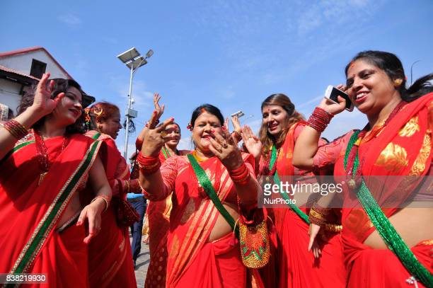 Nepalese devotees woman dance during Teej festival celebrations at Pashupatinath Temple Kathmandu Nepal on Thursday August 24 2017 The Teej festival...