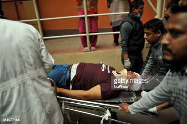 Nepalese doctors pulling the stretcher of a survivor of USBangla plane crash for further treatment at Kathmandu Medical College Hospital at Kathmandu...