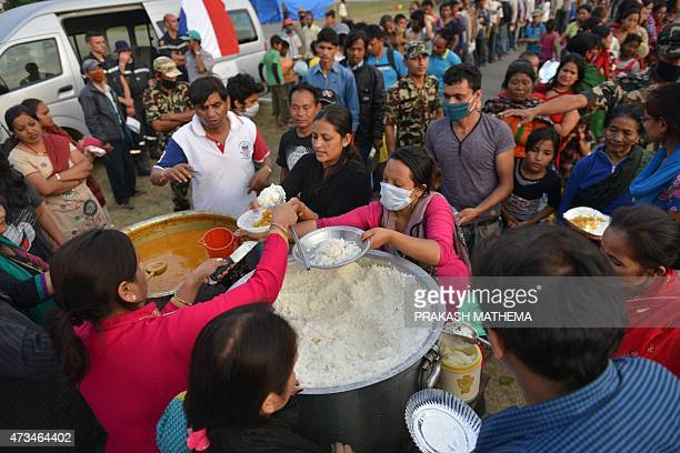 Nepalese earthquake survivors queue for relief food at an open ground shelter in Kathmandu on May 15 2015 Nearly 8500 people have now been confirmed...