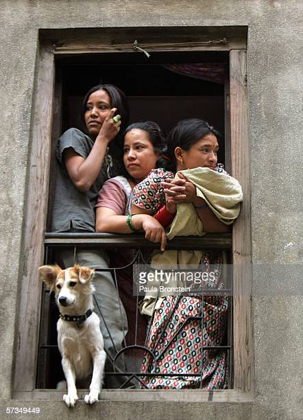 Nepalese family watches a protest from their window as demonstrations continue against the rule of King Gyanendra April 17, 2006 in Kathmandu, Nepal....