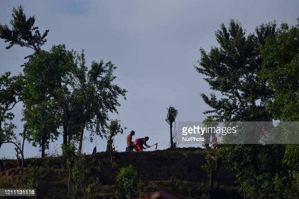 Nepalese farmers working on field for plantation during lockdown as concerns about the spread of Corona Virus at Thankot, Kathmandu, Nepal on Monday,...