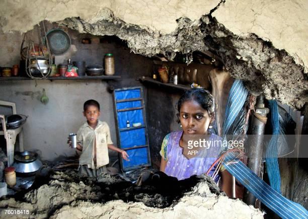 Nepalese flood victim Jarina Salmani poses in the ruins of her home in Nepalgunj, some 350 kilometres southwest of Kathmandu, 06 August 2007, after...