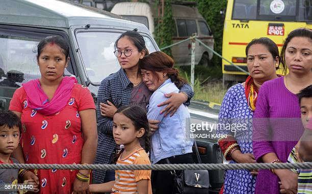 Nepalese friends and relatives of those killed in a helicopter crash react as the bodies of the victims are brought to a morgue of the Teaching...