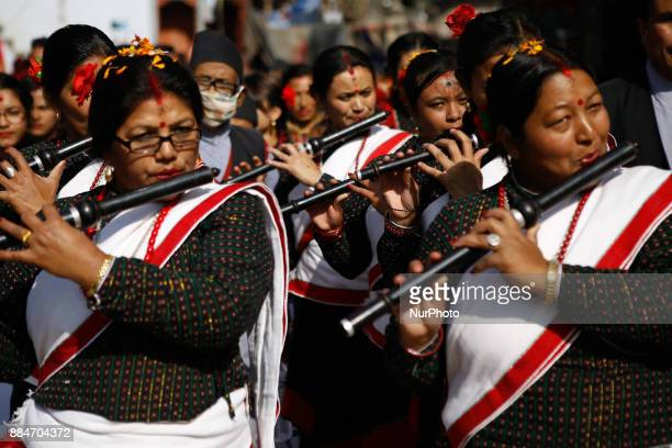 Nepalese from Newar community in traditional attire play flute as they participate in the parade marking Yomari Purnima and Jyapu Day in Kathmandu...