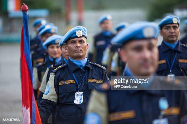 Nepalese garrison stands at attention during the official closing ceremony of the United Nations Stabilization Mission in Haiti in Tabarre Haiti on...