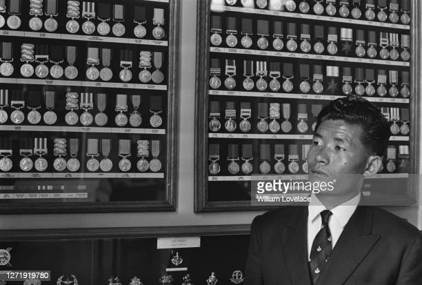 Nepalese Ghurkha Rambahadur Limbu at an exhibition of military cap badges during a visit to London to receive the Victoria Cross for his actions in...