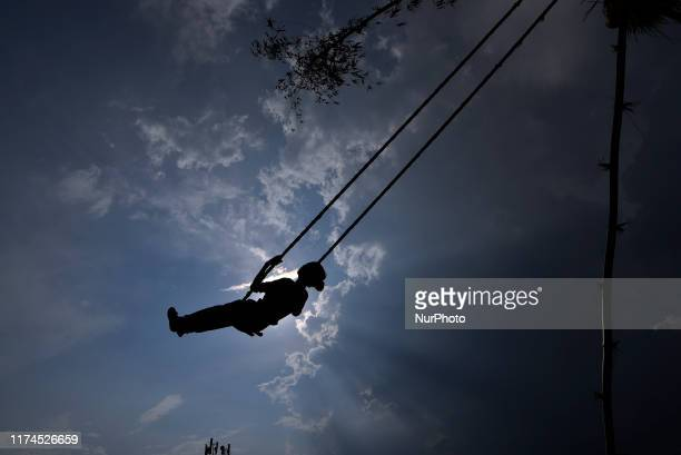 A Nepalese girl play on a traditional bamboo ping or swing during Dashain festival celebration at Shankharapur Kathmandu Nepal on Tuesday October 08...
