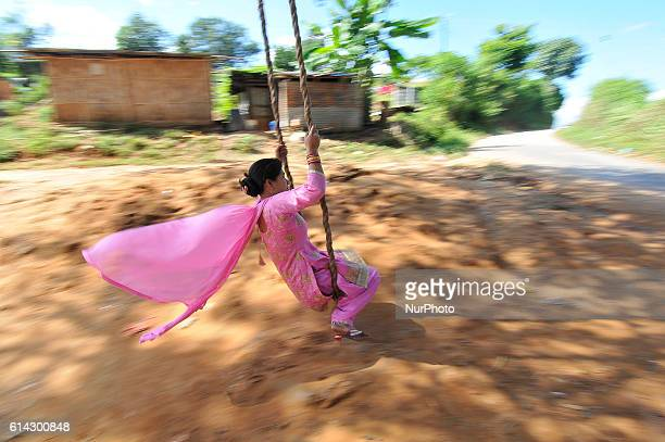 A Nepalese girl plays on a traditional bamboo ping or swing during Dashain festival celebration at Kavrepalanchok District Kavre Nepal on Thursday...