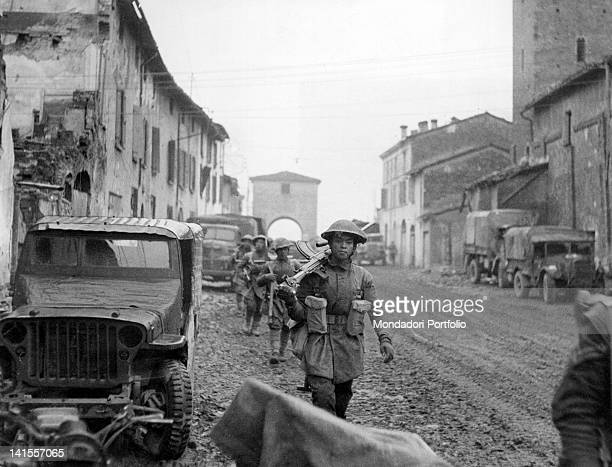 Nepalese Gurkha soldiers advancing among the ruins of a village north of Faenza Emilia Romagna Italy 23rd December 1944