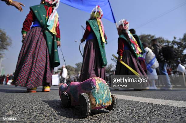Nepalese Gurung community girl rolling wodden horse in a traditional attire during the celebration of Tamu Lhosar or Losar at Kathmandu Nepal on...