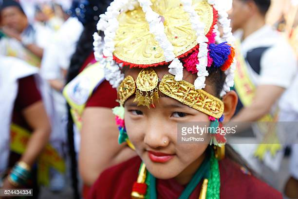 Nepalese Gurung community girl wearing traditional dress looks on as she take part in a parade to mark their New Year known as 'Tamu Losar' in...