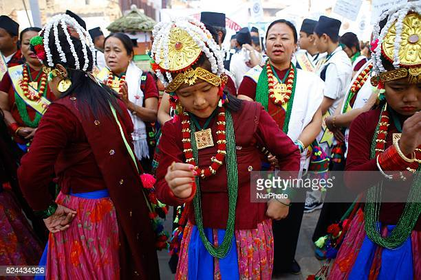 Nepalese Gurung community men and women wearing traditional dress dance as they take part in a parade to mark their New Year known as 'Tamu Losar' in...