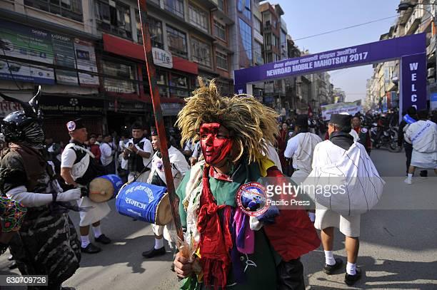 KATHMANDU NEPAL KATHMANDU NP NEPAL Nepalese Gurung community people dance in a tune of traditional instrument during the celebration of Tamu Lhosar...