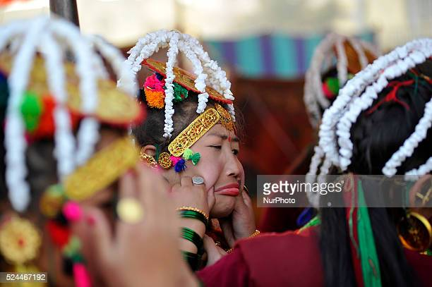 Nepalese Gurung community people plays with each other before traditional dance performance during the celebration of Tamu Loshar in Kathmandu Nepal...
