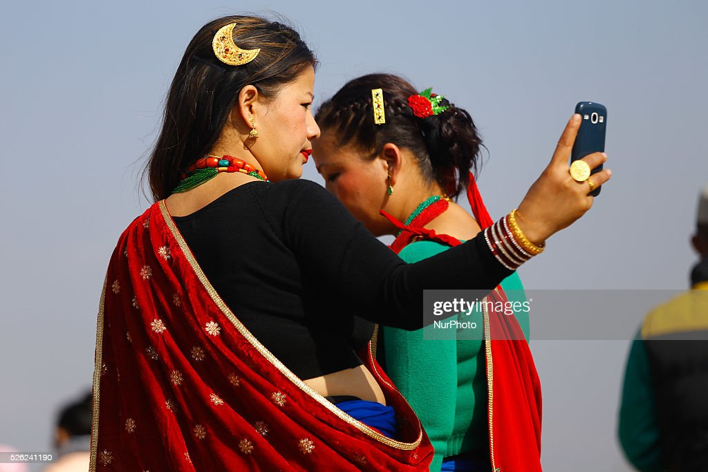 Tamu losar pictures and photos getty images nepalese gurung community women wearing traditional dress take picture from her phone as they take part tamu losar new year parade m4hsunfo