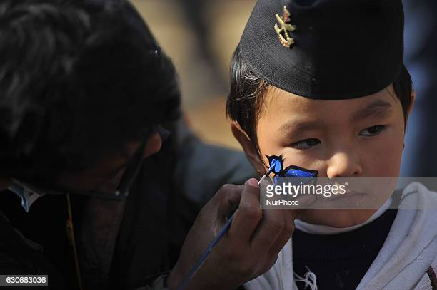 A Nepalese Gurung kid having face paint in a traditional attire during the celebration of Tamu Lhosar or Losar at Kathmandu Nepal on Friday December...
