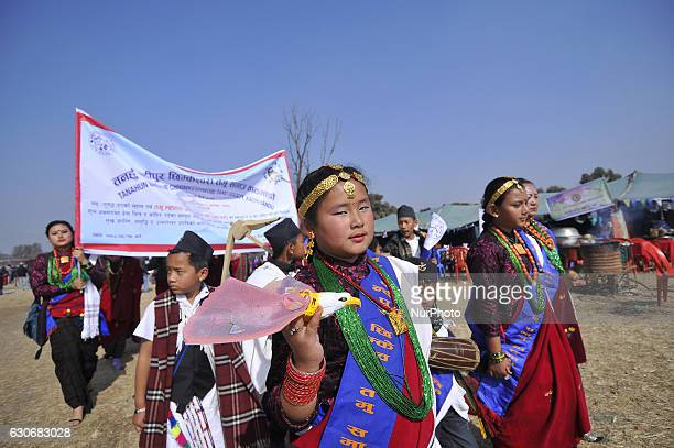 Nepalese Gurung kid hold woden toy Bird in a traditional attire during the celebration of Tamu Lhosar or Losar at Kathmandu Nepal on Friday December...