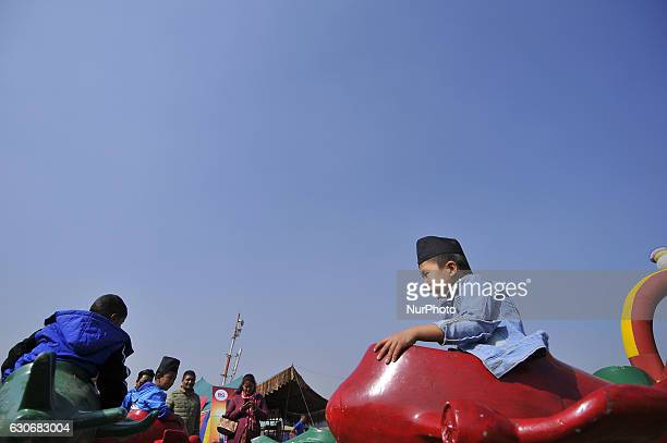 Nepalese Gurung kid playing in a traditional attire during the celebration of Tamu Lhosar or Losar at Kathmandu Nepal on Friday December 30 2016...