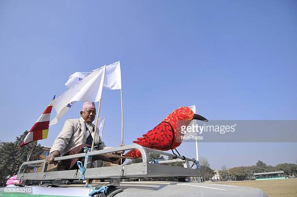 A Nepalese gurung man holds a statue of Birds on a parade during the celebration of Tamu Lhosar or Losar at Kathmandu Nepal on Friday December 30...