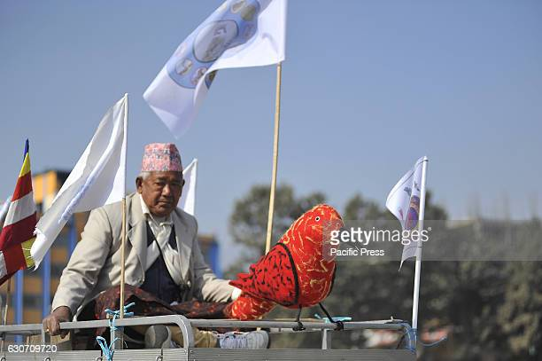 Nepalese gurung man holds a statue of Birds on a parade during the celebration of Tamu Lhosar or Losar at Kathmandu Nepal on Friday December 30 2016...