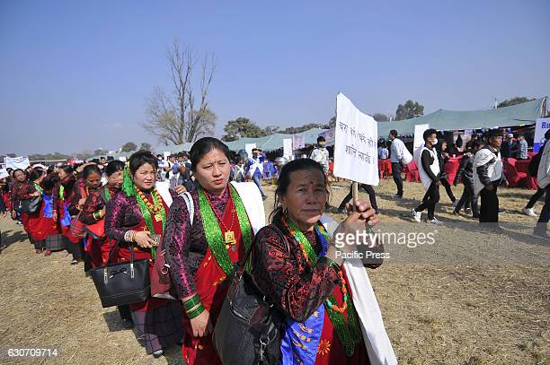 KATHMANDU NEPAL KATHMANDU NP NEPAL Nepalese Gurung woman wearing traditional attire during the celebration of Tamu Lhosar or Losar at Kathmandu Nepal...