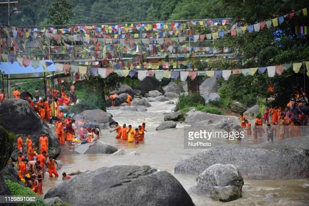 Nepalese Hindu arrives to collect holy water from Bagmati River during the Bol Bom pilgrimage at Sundarijal, Katmandu, Nepal on Monday, August 05,...