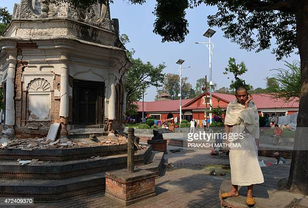 A Nepalese Hindu devotee looks on during a mourning ritual at the Pashupatinath temple in Kathmandu on May 7 2015 The 78 magnitude earthquake which...