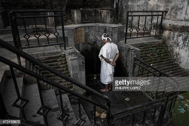 A Nepalese Hindu devotee takes part in a mourning ritual at the Pashupatinath temple in Kathmandu on May 7 2015 Nepal wrapped up a 13day period of...